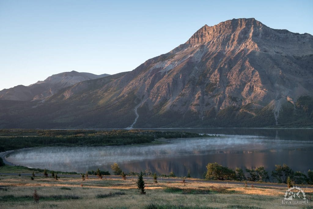 fog hangs over upper waterton lake in waterton lakes national park