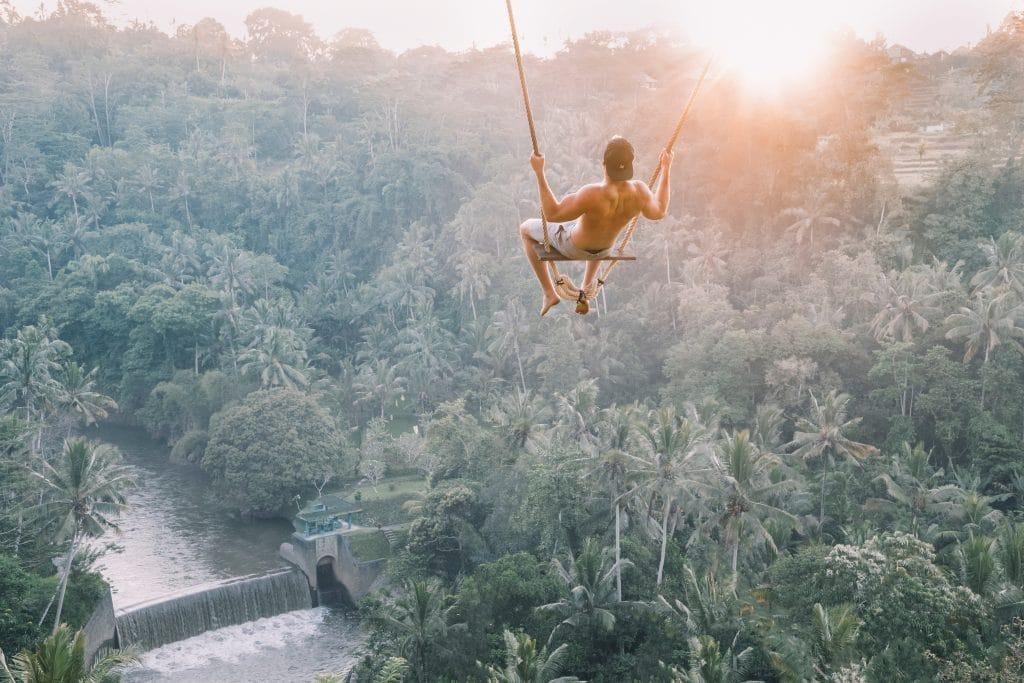 a lone traveller swings in bali
